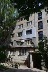 Продам гостинку в Харькове,  в кирпичном доме.